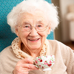 Old lady with a cup of tea